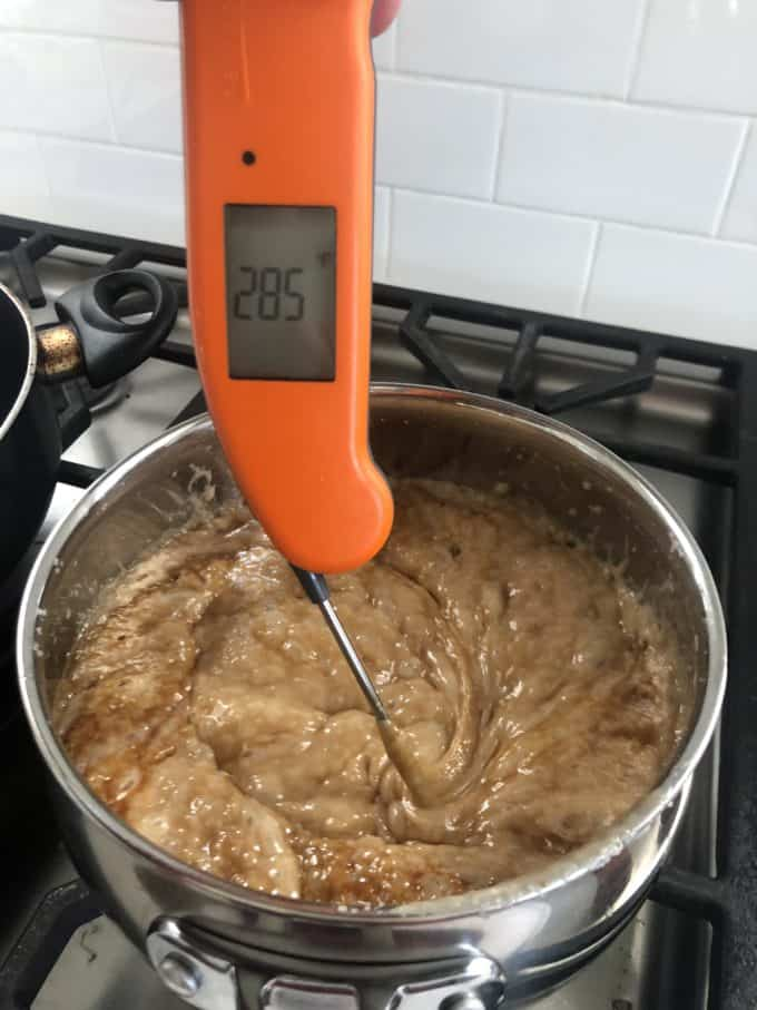boiling toffee with a thermometer on the stove