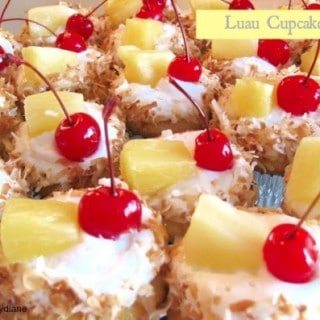 luau pineapple and toasted coconut with pineapple frosting topped with a cherry