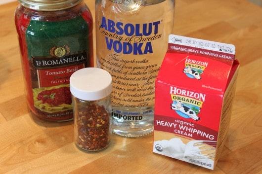 In medium saucepan, heat tomato sauce and vodka,