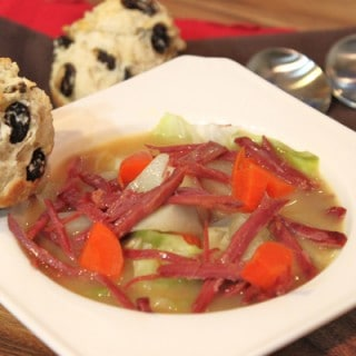 corned beef soup in a bowl with irish soda bread muffins