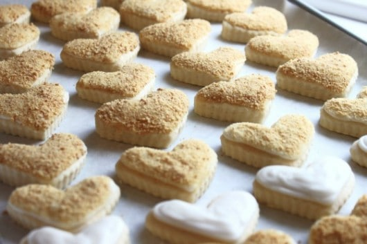 cheesecake cookies with cheesecake icing and graham cracker crumbs