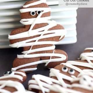 Chocolate Pumpkin Cut Out Cookies decorated like Mummys for Halloween @createdbydiane