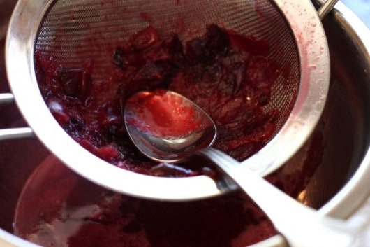 straining cherries for cherry syrup @createdbydiane.jpg
