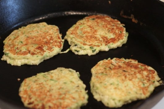 cooking zucchini cakes @createdbydiane