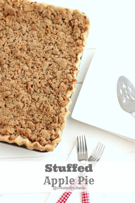 recipe from Created by Diane a delicious Stuffed Apple Pie with a yummy sour cream filling, that will remind you of cheesecake @createdbydiane #recipe #pie #piecrust #applepie #crumbtopping