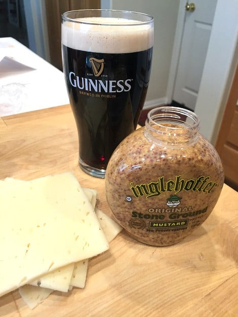 guinness and stone ground mustard with swiss cheese