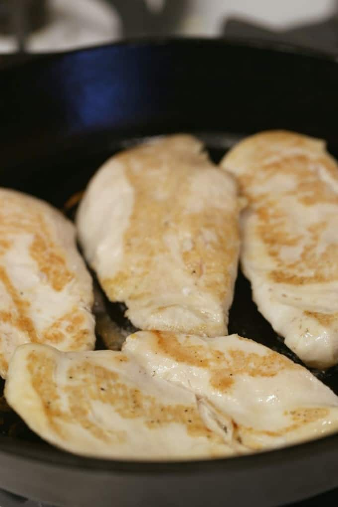 cooking chicken in a cast iron skillet @createdbydiane