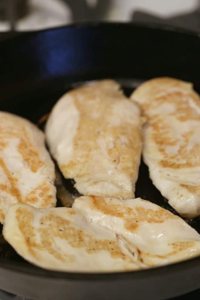 cooking chicken in a cast iron skillet @createdbydiane