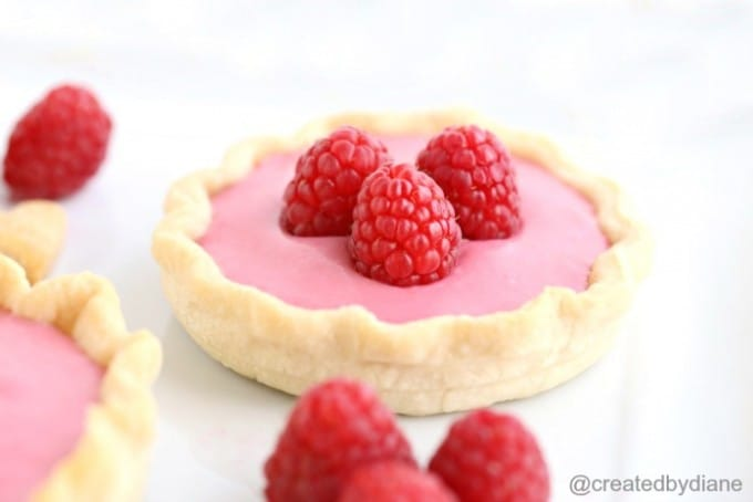 stove top raspberry cheesecake from @createdbydiane made in mini pie crust in mason jar lids