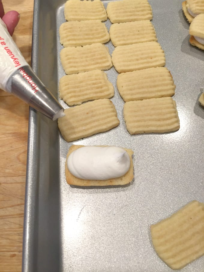 filling spritz cookies with frosting @createdbydiane