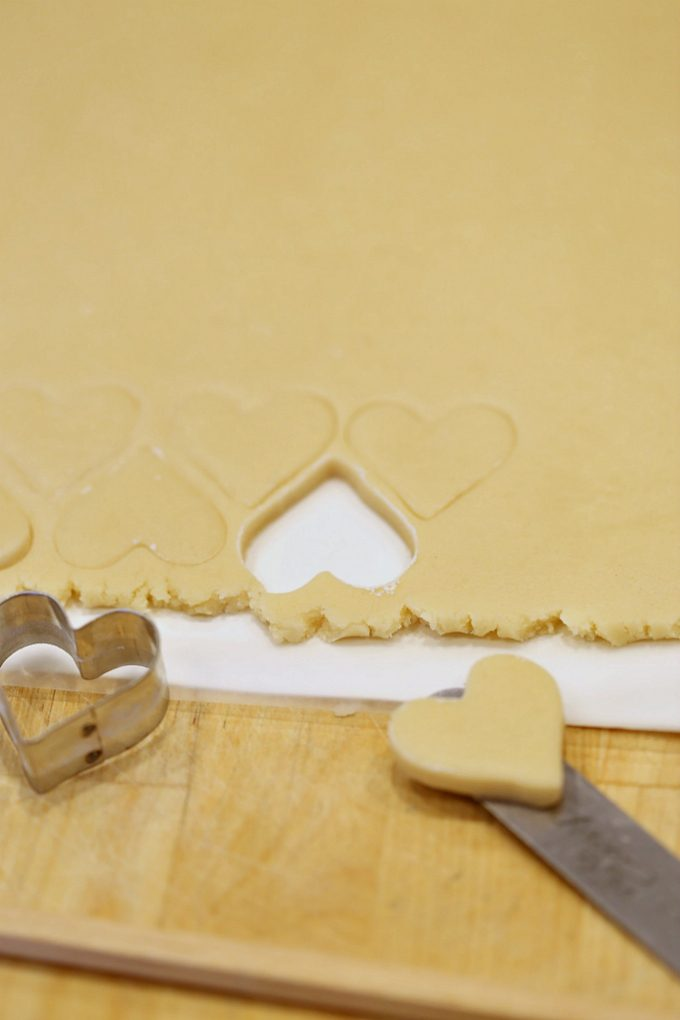 cutting-cookies-with-cookie-cutters-and-moving-them-to-a-baking-sheet-for-perfect-cookies-createdbydiane