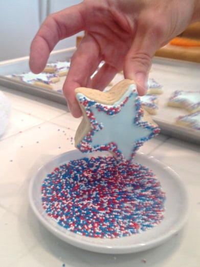 decorating cookies with icing and sprinkles