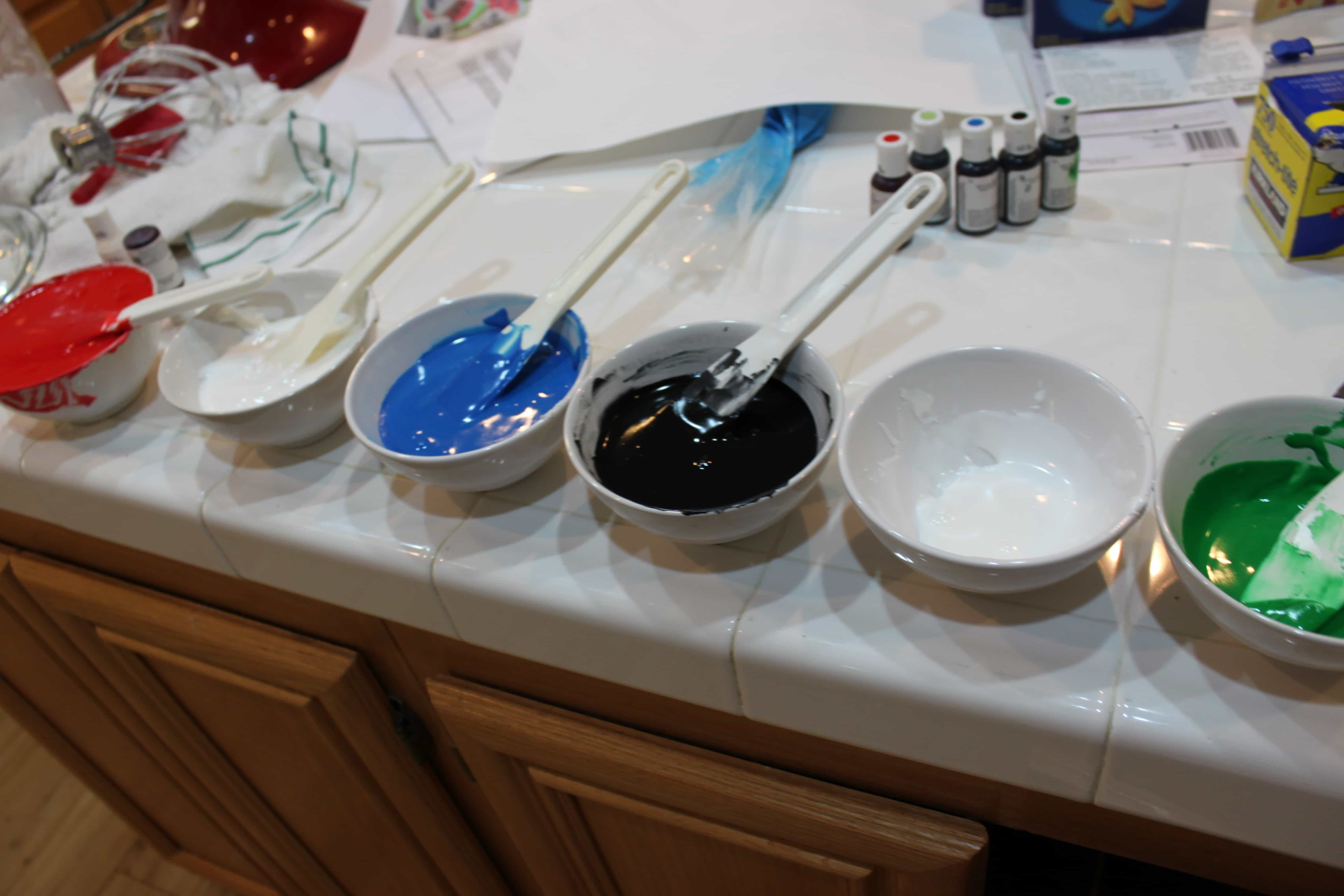 icing, mixing color of icing for decorating cookies with a piping bag @createdbydiane