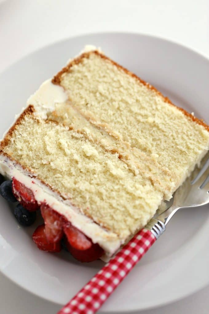 a slice of the best vanilla cake recipe