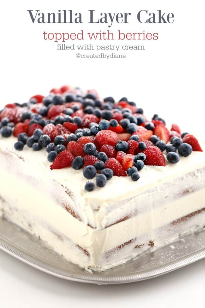 Vanilla Layer Cake topped with berries filled with pastry cream, the EVERY-TIME Cak