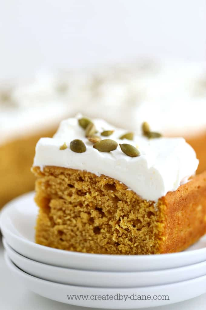 pumpkin cake with whipped cream and pumpkin seeds @createdbydiane