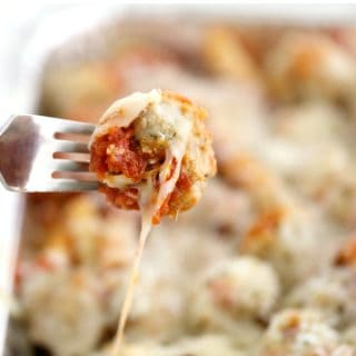 fork with chicken meatball casserole dish for a crowd