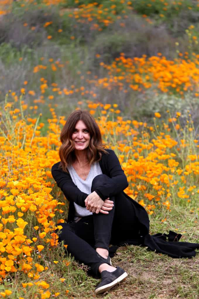 Diane Schmidt at poppy flower fields in Southern California's Super Bloom Created by Diane Food Blogger