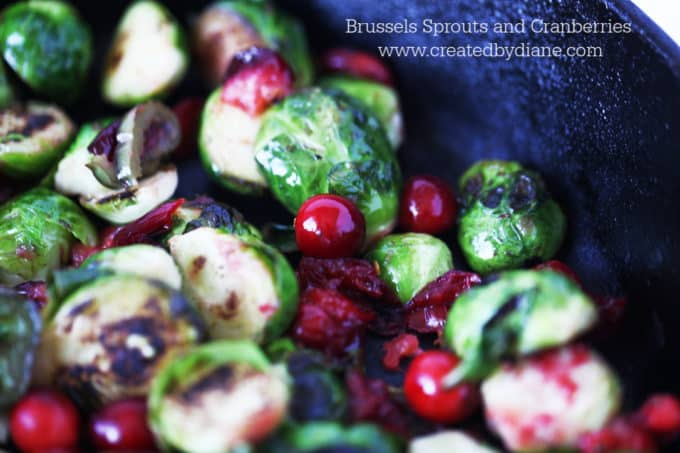 cast iron skillet cooking vegetables brussels sprouts with cranberries and jalapeno