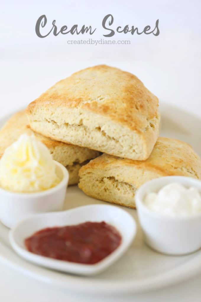 cream scones with butter, jam and whipped cream