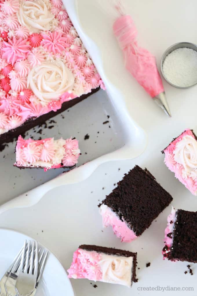 pink frosting decorated chocolate cake in the pan