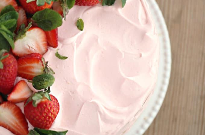 homemade strawberry cake, vanilla ckae with strawberry curd filling, topped with strawberry swiss meringue frosting createdbydiane.com