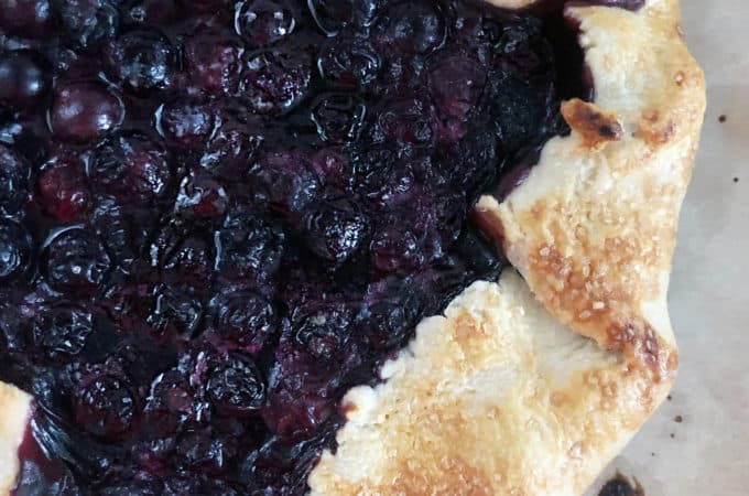 blueberry galette with a crisp crust full of delicious blueberries looks rustic and easy to make
