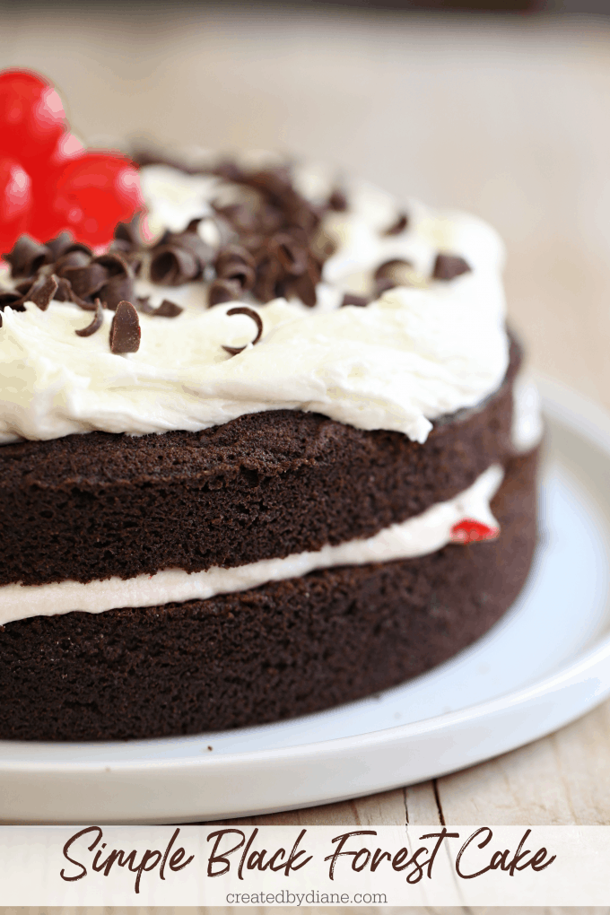 easy 8 round single cake cut in half, black forest cake with cherries and chocolate curls createdbydiane.com