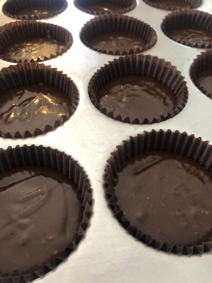 chocolate cupcake batter in liners for perfect cupcakes 3 tablespoons of batter in each portion createdbydiane.com